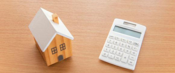 A tiny house model and a calculator
